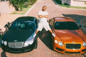 Cassper Nyovest poses on his Bentleys...but check out how his photographer took the photo...lol